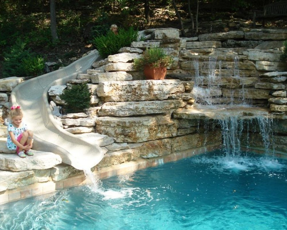 slides and falls by the pool