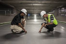 two men checking the concrete floors